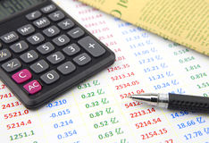 Ball-pen and calculator on data sheet Stock Photo