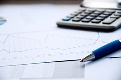 Ball pen, the calculator, documents. Business collage Royalty Free Stock Photography