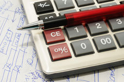 Ball pen, calculator and text. Written especially for this photo Royalty Free Stock Image