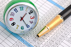 Ball pen and clock on datasheet Stock Photos