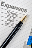 Ball pen on expenses page Royalty Free Stock Photos