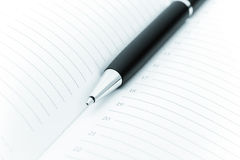 Ball pen and office pad Royalty Free Stock Image