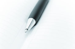 Ball pen and office pad Stock Images