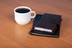 Ball pen, organizer and cup of coffee Royalty Free Stock Image