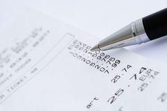 Ball pen with receipt from shop Royalty Free Stock Photography