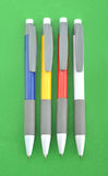 Ball pens. Four ball pens in green background Royalty Free Stock Photos