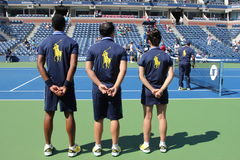Ball persons on tennis court at the Billie Jean King National Tennis Center Stock Photo