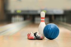 Ball, pin and shoes on floor. In bowling club Royalty Free Stock Photos