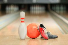Ball, pin and shoes on floor. In bowling club Stock Photo