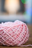 Ball of pink knitting yarn with ribbon Stock Photography