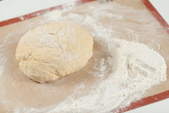 Ball of pizza dough on background. With dusting of flour Stock Image