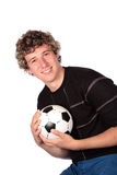 Ball player. Football player in black top holding soccer ball Stock Photography