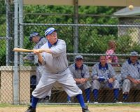 Ball player swings the bat Royalty Free Stock Photography