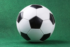 Ball for playing football. On a green background Stock Photography