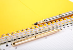 Ball-point and fountain pen writing-book. On a spiral close up stock images
