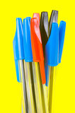 Ball Point Pens. Isolated against a yellow background Stock Images