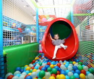 Ball pool. The child who is taking off from a pipe in ball pool Stock Photo