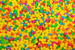 Ball pool in the children`s playroom. colorful plastic balls on children`s playground. stock photos