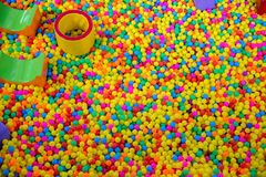 Ball pool in the children`s playroom. colorful plastic balls on children`s playground. royalty free stock images