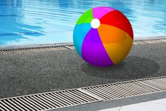 Ball at poolside. Illustration of a colourful plastic ball at poolside stock photo