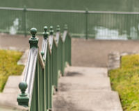 Ball on Post of Green Railing. Along concrete stairs stock photos