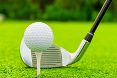Ball and putter close-up Royalty Free Stock Images