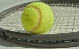Ball and racket. Tennisball on a tennis racket royalty free stock photos