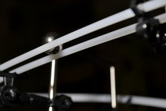 Ball on rails in dark Royalty Free Stock Image