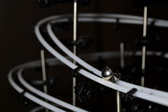Ball on rails in dark Royalty Free Stock Images