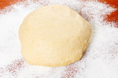 Ball of raw dough and flour Royalty Free Stock Images