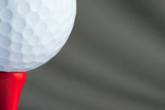 Ball on red tee. White golf ball on red golf tee Stock Photos