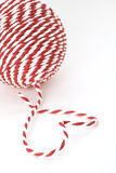 Ball of red and white rope with a heart Stock Images