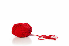 Ball of red wool. On white background Royalty Free Stock Images