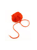 Ball of red yarn. On white background Royalty Free Stock Photography