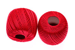 Ball of red yarn Stock Images