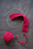 Ball of red yarn and knitting Royalty Free Stock Images