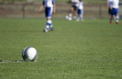 Ball At Rest. A soccer ball sits at midfield Royalty Free Stock Images