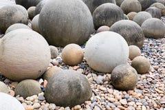 Ball rock in public garden. Rock in circle shape which shot form public garden Royalty Free Stock Photo
