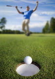 Ball rolling into the hole Royalty Free Stock Photography