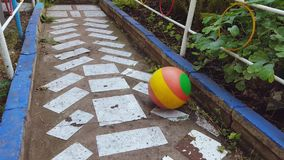 Ball rolls along the path stock footage