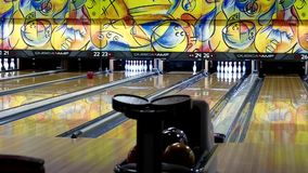 Ball rolls down a bowling lane for a strike stock footage