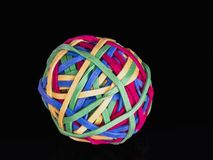 0585 ball of rubber bands, black background stock images