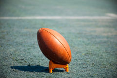 Ball rugby. Oval ball rugby stadium stands on the grass royalty free stock photos