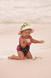 Ball of Sand. Little girl at the beach holding a ball of sand Royalty Free Stock Images