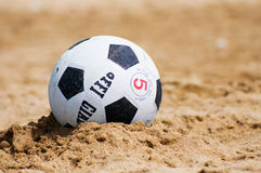 Ball on sand Stock Photography