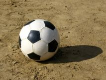 Ball on the sand. Playing field royalty free stock photo