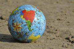 Ball on the sand. Beach ball sea summer play Royalty Free Stock Photos
