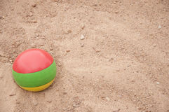 The ball in the sand Stock Images