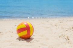 Ball on sand near sea Stock Photos