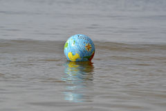 Ball in sea. Ball beaches summer vacations water Stock Images